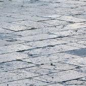 Pavimento de ladrillo viejo en la ciudad — Foto de Stock