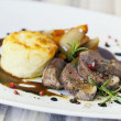 Sliced lamb steak with potatoe gratin and different vegetable — Stock Photo