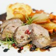 Stock Photo: Sliced lamb steak with potatoe gratin and different vegetable