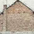 House shape on brick wall - Stock Photo
