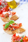 Fresh homemade crispy Italian antipasto called Bruschetta topped — Stock Photo