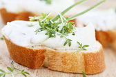 Fresh cream cheese on baguette — Stock Photo