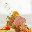 Roasted saddle of lamb on asparagus ragout and herbs — Stock Photo #21526879
