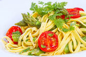 Tagliarini pasta with asparagus and cherry tomato — Stock Photo