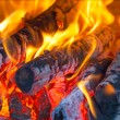 Stock Photo: Fire wood burns in fireplace
