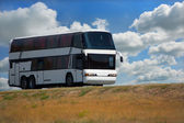 Bus on country highway — Стоковое фото