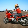Biker and red motorcycle — Stock Photo