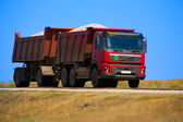 Red dump truck with the trailer — Stock Photo