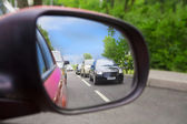 Reflection in an automobile mirror — Stock Photo