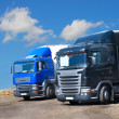Two trucks against the sky — Stock Photo