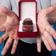 Stock Photo: Box with car in mans hands