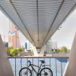 Bicycle parked under bridge footings - Lizenzfreies Foto