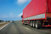 Red trailer on the highway — Stock Photo