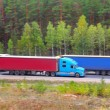 Stock Photo: Trucks transporting cargo