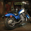 Motorcycle in garage - Stock Photo