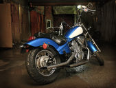 Motorcycle in garage — Stock Photo