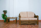 Sofa and rattan table — Stock Photo