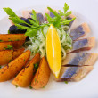 Herring with baked potato on plate — Stockfoto