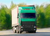 Truck goes on the highway — Stock Photo