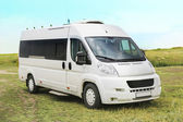 White minibus on in the field — Stock Photo