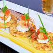 Pancakes with shrimps and caviar — Stock Photo