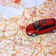 Car toy on map — Stock Photo #33591805