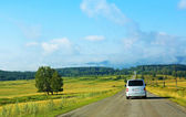 Minibus on the country highway — Stock Photo