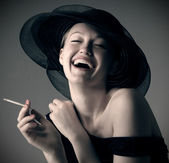 Beautiful laughing girl in hat — Stock Photo