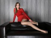 Beautiful slender girl in red dress — Stock Photo