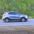 SUV moves on the country road — Stock Photo #38802097