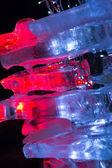 Pieces of ice illuminated — Stock Photo