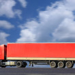 Red truck goes on the way — Stock Photo