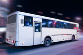 Bus moving on the night city — Stock Photo