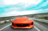 Sports car goes on the highway — Stock Photo