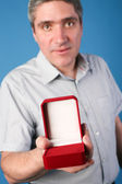 Man with an open red gift box — Stock Photo