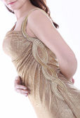 Female torso in gold dress — Stock Photo