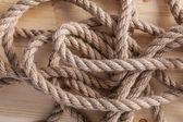 Rope on wooden board — ストック写真