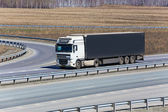 Truck goes on a highway — Stock Photo
