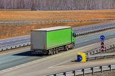 Truck goes on the country highway — Stock Photo