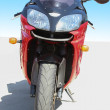 Red motorcycle on road — Stock Photo #48607577