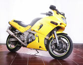 Yellow motorcycle in studio  — Stock Photo