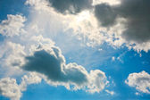 Sky with clouds closing the sun — Stock Photo