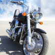 Motorcycle on asphalt against sky — Stock Photo #49555317