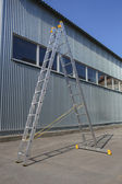 Step-ladder at warehouse wall — Stock Photo