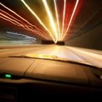 Car goes on night city — Stock Photo #9882995