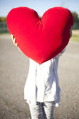 Young girl holding a heart — Photo