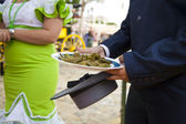 Fried pepper in the hands of ride at the Seville Fair , Spain — Stock Photo