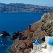 Blue domes of Santorini - Stock Photo