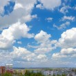 The sky over the city. Panorama - Stock Photo