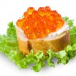 Red caviar with bread on black — Stock Photo